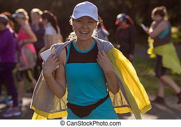 Cheerful woman in sportswear