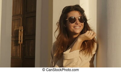 Cheerful woman in sunglasses - Pretty woman in coat and...