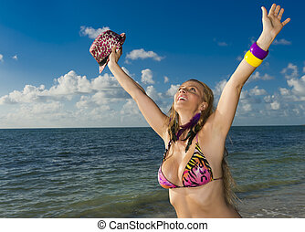 Cheerful woman in the beach