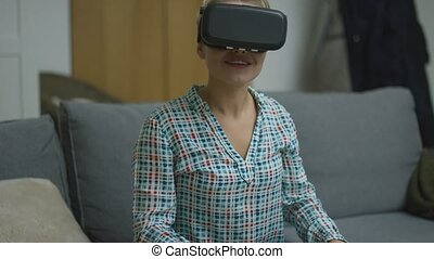 Cheerful woman in VR headset