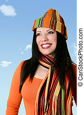 Cheerful woman in winter scarf and hat