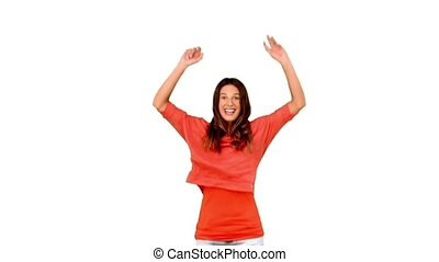 Cheerful woman jumping against white background in slow motion