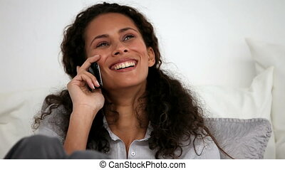 Cheerful woman on the phone