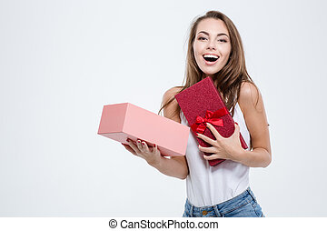 Cheerful woman opening gift box