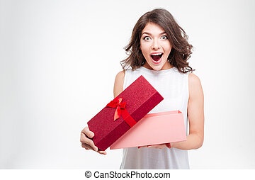 Cheerful woman opening present box