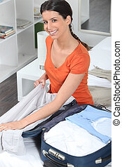 Cheerful woman packing