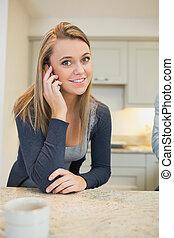 Cheerful woman phoning