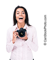 Cheerful woman photographer with camera