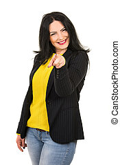 Cheerful woman pointing to you