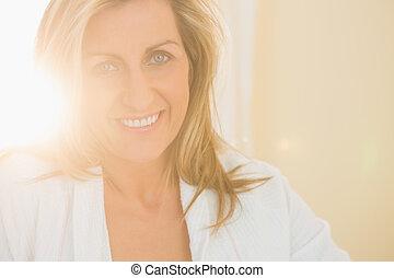 Cheerful woman posing and looking at camera