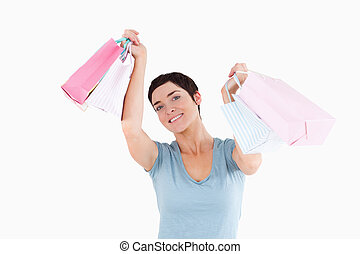 Cheerful woman posing with shopping bags
