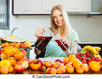woman pouring beverages with fruits