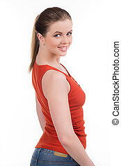Cheerful woman. Rear view of happy young women looking over shoulder while standing isolated on white