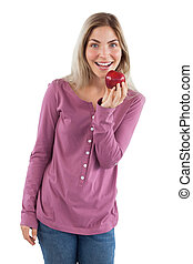 Cheerful woman showing an apple