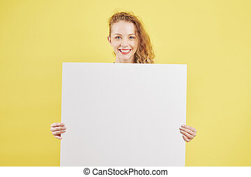 Cheerful woman showing paper placard