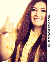 Cheerful woman showing thumb up