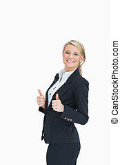 Cheerful woman showing thumbs up