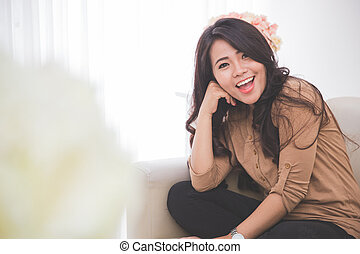Cheerful woman sitting on a couch