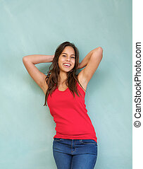 Cheerful woman smiling with hands in hair