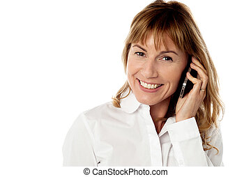 Cheerful woman speaking over cellphone