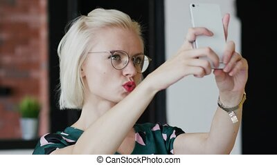 Cheerful woman taking pictures at home - Beautiful young...