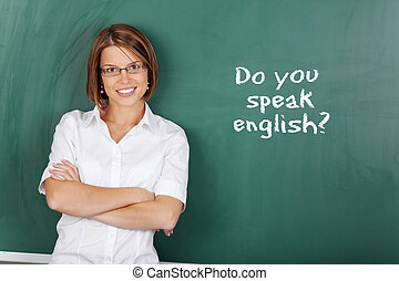English class - Cheerful woman teaching English class at the...