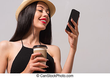 Cheerful woman using cell phone