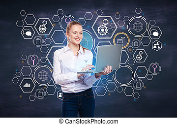 Cheerful woman using laptop with hologram
