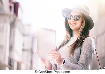Cheerful woman using tablet