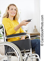 cheerful woman watching television in living room