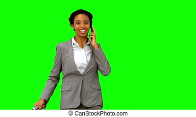 Cheerful woman waving at someone on green screen in slow...