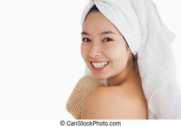Cheerful woman wearing a towel