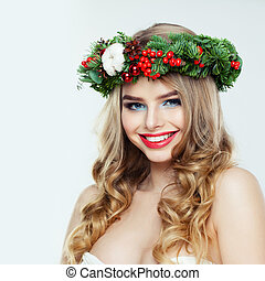 Cheerful woman with Christmas garland smiling on white background