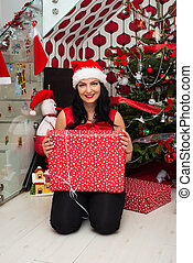 Cheerful woman with Christmas gift