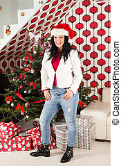 Cheerful woman with Christmas tree