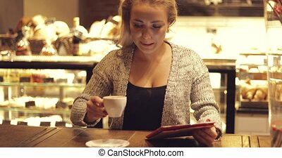 Cheerful woman with coffee and tablet