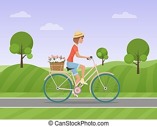 Cheerful woman with flowers in the basket riding a bike on a park road. Vector illustration.