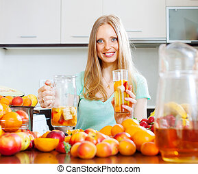 cheerful woman with fruits beverage