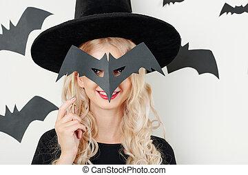 Cheerful woman with Halloween mask