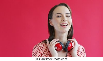 Cheerful woman with headphones - Beautiful young lady with...