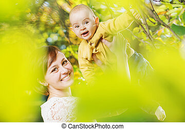 Cheerful woman with her child