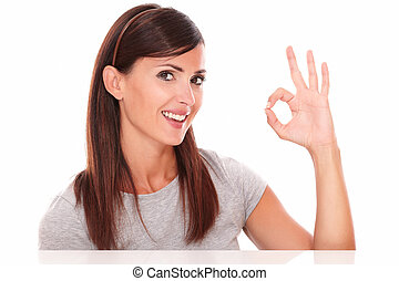 Cheerful woman with ok sign looking at camera