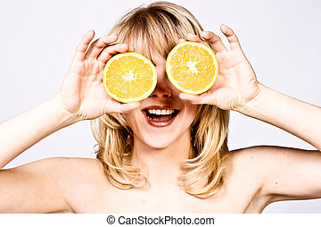 cheerful woman with oranges