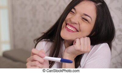 Cheerful woman with pregnancy test - Woman happy to know...