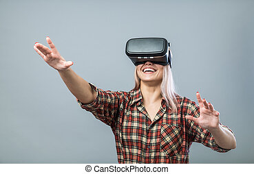 Cheerful woman with vr headset