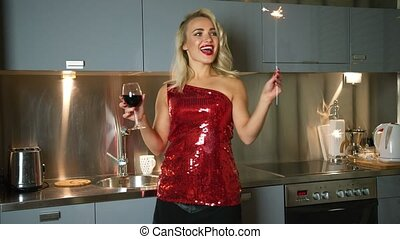 Cheerful woman with wine and sparkler