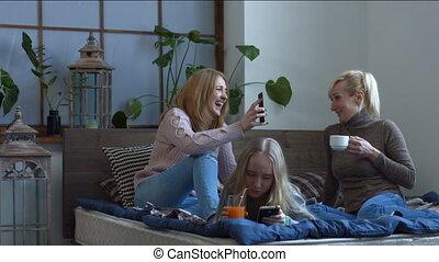 Cheerful women chatting and gossiping at home - Joyful...