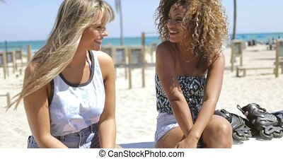 Cheerful women chatting on beach