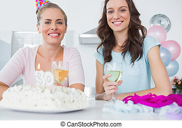 Cheerful women with birthday cake