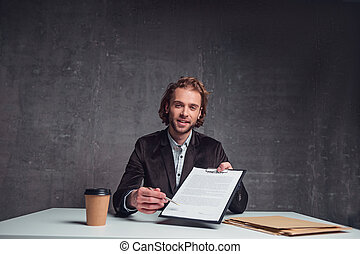 Cheerful worker giving treaty for signing it